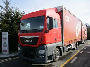 camião com lona deslizante MAN TGX 26.400 6x2 E6