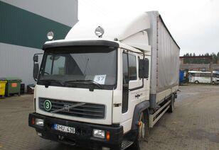 camião de toldo VOLVO FL6