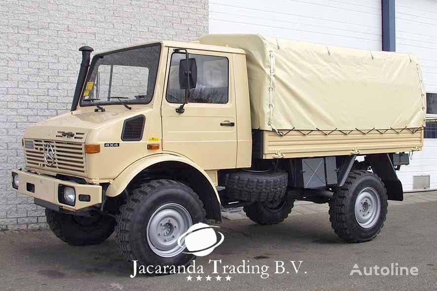 camião de toldo MERCEDES-BENZ UNIMOG 1300