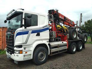 camião de transporte de madeira SCANIA R580 V8 with JONSERED 2490 and trailer DOLL + reboque de transporte de madeira