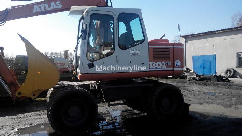 ATLAS 1302 escavadora de rodas